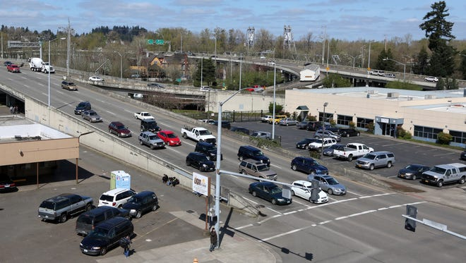 Traffic moves over the Center Street Bridge on Friday, March 31, 2017, in downtown Salem.