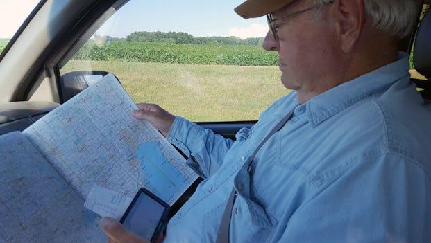 Bob Manzke tries to navigate through Wisconsin via map and GPS.