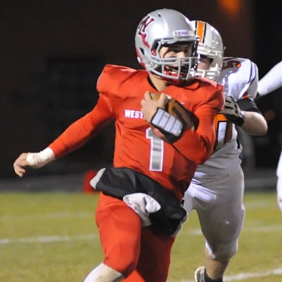 West Side quarterback Mikey Kidwell weaves the ball