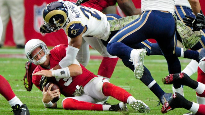 Arizona Cardinals quarterback Carson Palmer after a sack.
