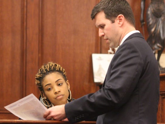 Chris Clark, Hurley's attorney, shows Crystal Harwell