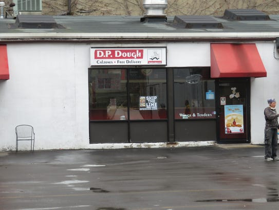The parking space in front of D.P. Dough will be transformed