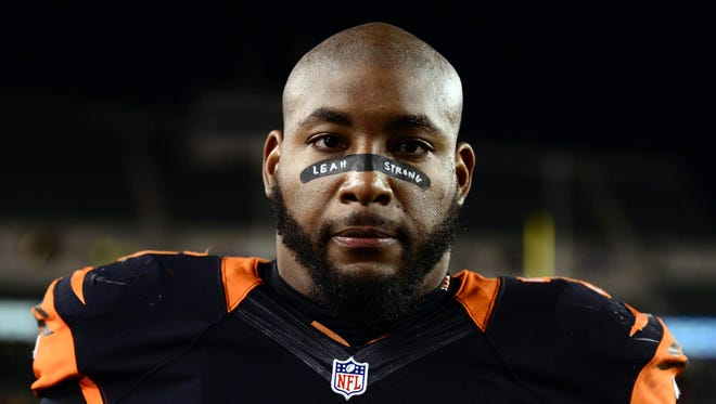 Cincinnati Bengals defensive tackle Devon Still (75) walks off the field after the game against the Cleveland Browns at Paul Brown Stadium.
