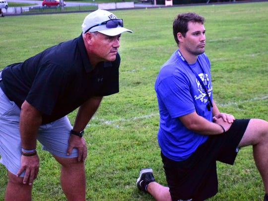 Steve Girolmo, left, made the trip from New York to Virginia almost every week last fall to help his son, Lee High head football coach Scott Girolmo, on the sidelines.