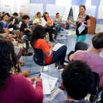 In this file photo, Monica Guzman, standing, Guam Council on the Arts and Humanities Agency chairwoman, addresses those in attendance at a FestPac meeting at the Guam Community College.