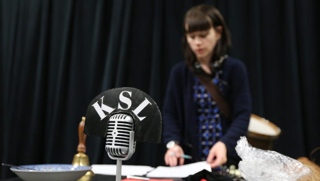 """Annie Rimmer-Weeks rehearses a scene for a new adaptation of """"A Christmas Carol"""" as a 1940s radio show on Tuesday, Nov. 29, 2016, at Willamette University in Salem. Actors use foley devices to make all the sound effects live on stage."""