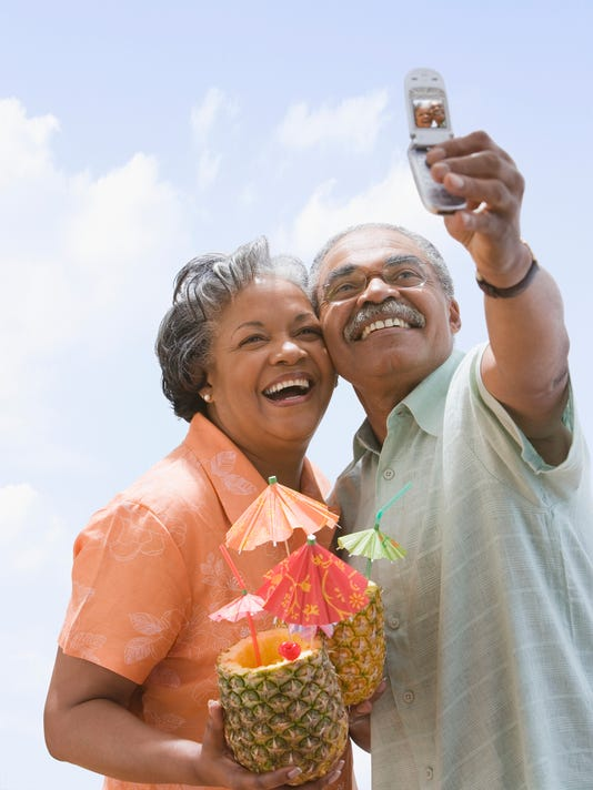 Senior African couple taking own photograph