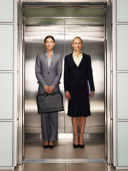 Businesswomen in Elevator