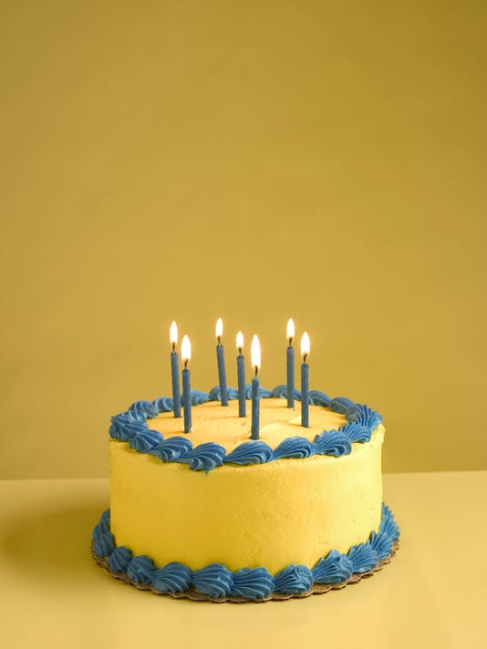 Close-up of lit up candles on a birthday cake