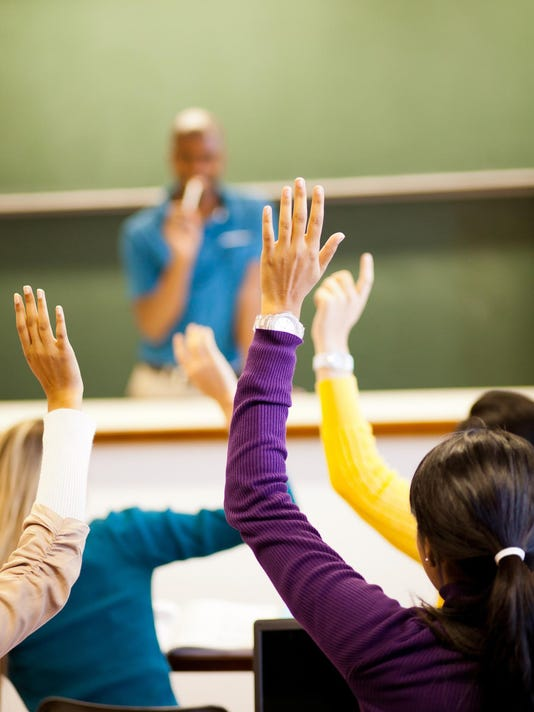 students arms up in classroom