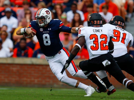 Auburn quarterback Jarrett Stidham (8) scrambles for yardage against Mercer during the first half of an NCAA college football game, Saturday, Sept. 16, 2017, in Auburn, Ala.