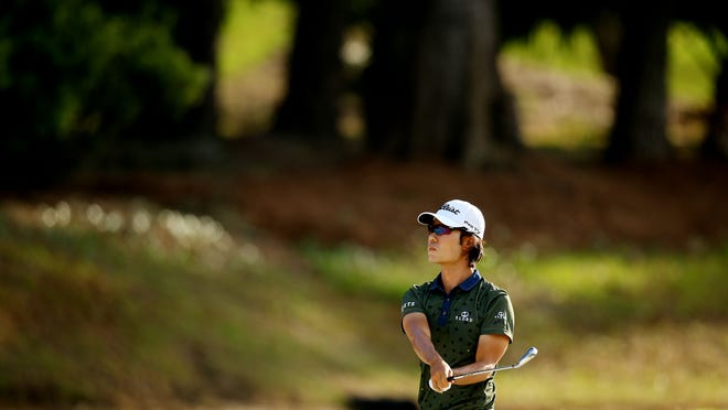 Kevin Na is one of four players tied at -5 for the lead at The Players Championship at the TPC at Sawgrass Stadium Course.
