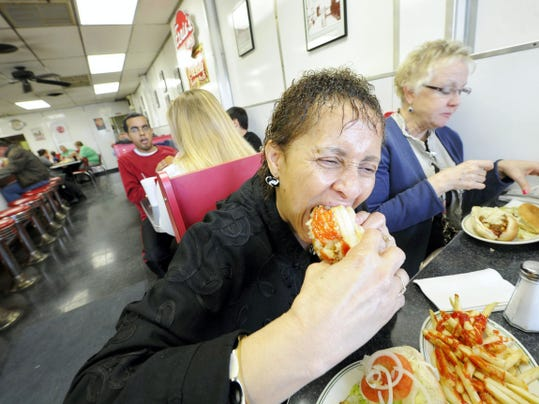 Helen Jones, a teacher at Gettysburg Area High School takes a chomp of the Texas wiener during lunch at Ernie's Texas Lunch on March 26.