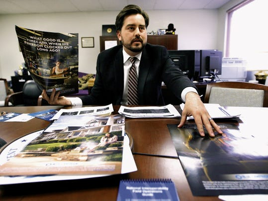 Gus Correa, supervisor of Homeland Security Investigations Anti-trafficking Coordination Team in El Paso, shows posters from the agency that hope to put a face on sex trafficking.