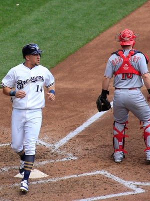 Milwaukee's Hernan Perez scores a run during the fifth inning.
