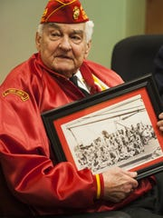 John Lauriello, 91, of Westmont holds a  1945 photo of the surviving Marines in his troop.