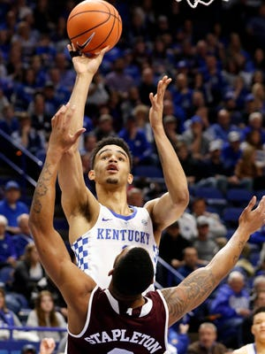 Kentucky's Sacha Killeya-Jones, top, shoots over the defense of Mississippi State's Xavian Stapleton (3) during the first half of an NCAA college basketball game, Tuesday, Jan. 23, 2018, in Lexington, Ky.