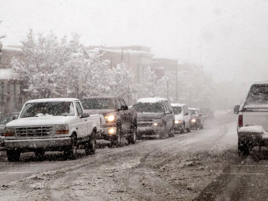 Snow falls as drivers navigate a slushy Cedar City Main Street in this Spectrum file photo from 2018.