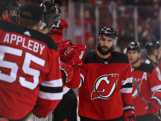 New Jersey Devils right wing Kyle Palmieri (21) celebrates