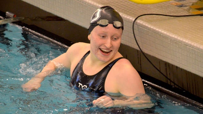 West Ottaw's Lilly Brandt celebrates after winning the 100-yard freestyle at the Division 1 state swim meet on Saturday at Hudsonville High School.