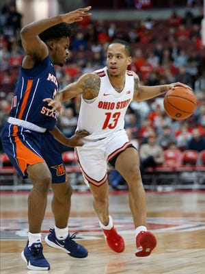 Ohio State's C.J. Walker, right, looks for an open pass as Morgan State's Sherwyn Devonish defends during the second half of an NCAA college basketball game Friday, Nov. 29, 2019, in Columbus, Ohio. Ohio State beat Morgan State 90-57. (AP Photo/Jay LaPrete)