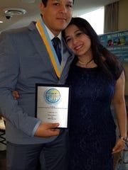 Ridgewood High School Film Club members with the award for their peace film.
