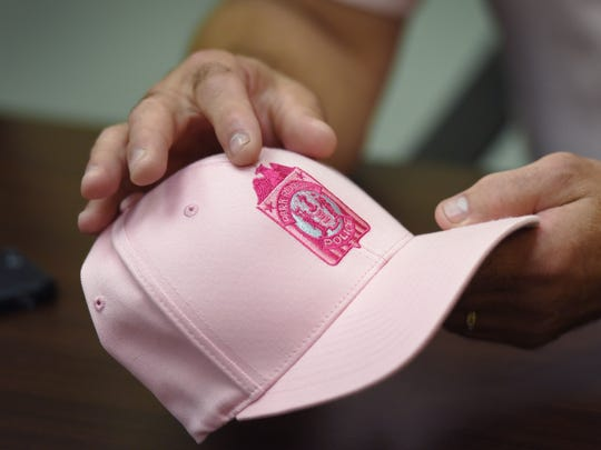 One of the campaign's pink hats is held by Nicholas Errico.