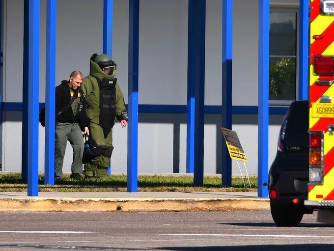 BCSO bomb squasd member exits the school. Titusville