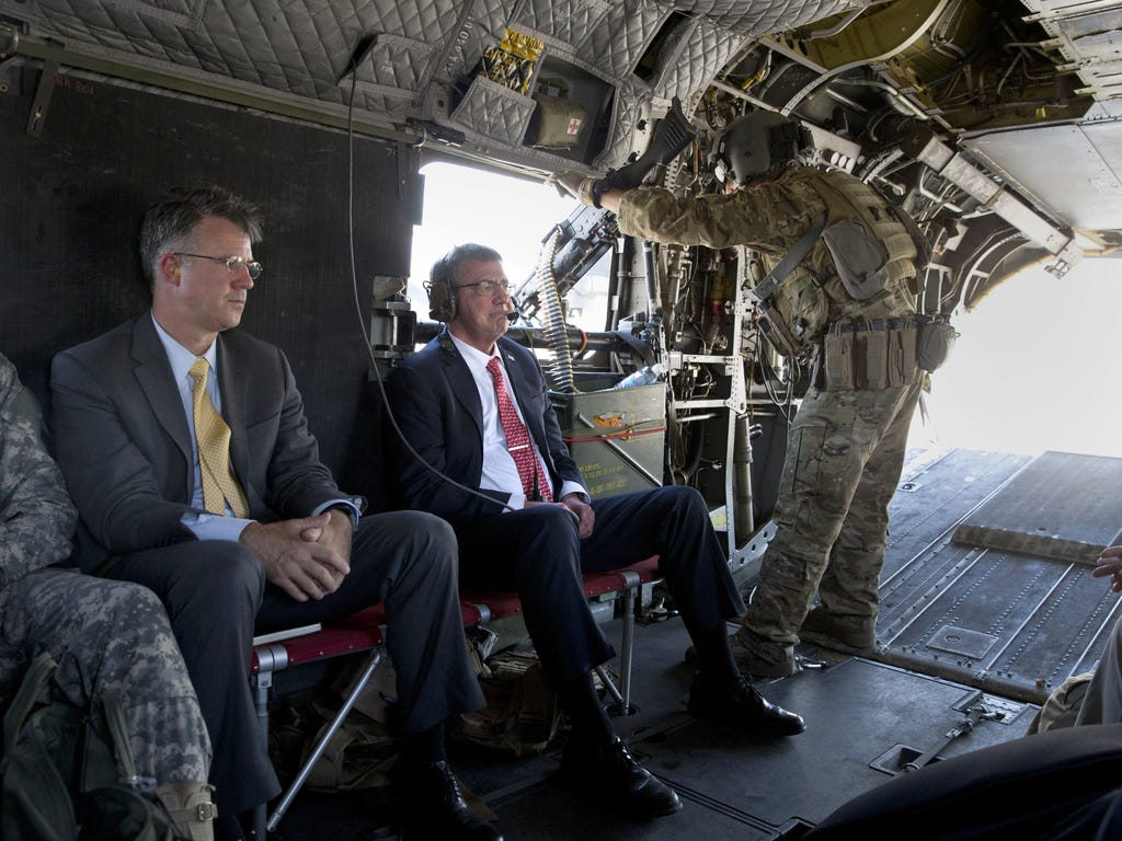 U.S. Defense Secretary Ash Carter rides on a Chinook helicopter with his chief of staff, Eric Rosenbach, in Baghdad. Carter is on a week-long tour of the Middle East focused on reassuring allies about Iran and assessing progress in the coalition air