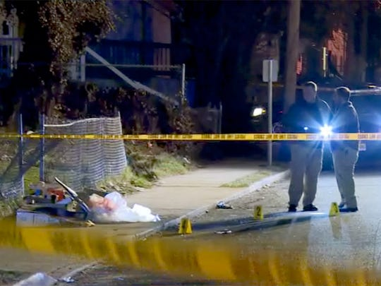 Asbury Park Police and Monmouth County Prosecutor investigate a fatal shooting scene on Ridge Avenue in Asbury Park early Thursday morning, February 22, 2018.