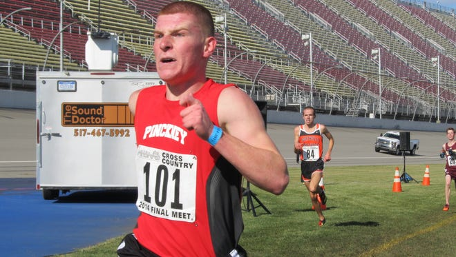 Pinckney's Isaac Harris shows the strain of his effort as he races to the finish line Saturday. It paid off in a spot on the all-state team for Harris