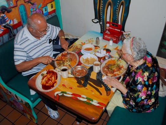 Frequent customers Ruben and Alicia Garcia share lunch