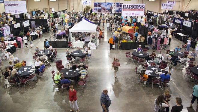 St. George women browse the commercial booths at the What Women Want Expo Friday, Oct. 24, 2014.