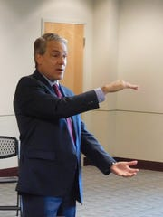 Dr. Ron Paulus, president and CEO of Mission Health, discusses the possible sale of the health system to HCA Healthcare at a May meeting  of the Council of Independent Business Owners.