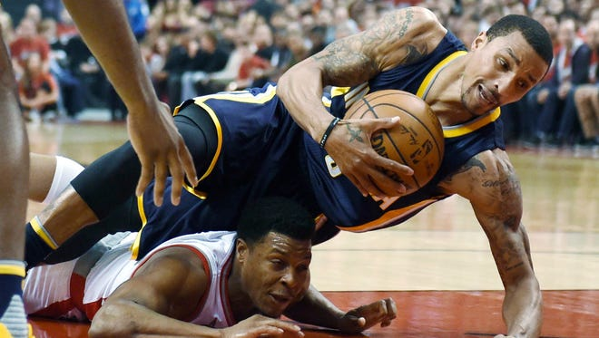 Toronto Raptors guard Kyle Lowry, bottom left, and Indiana Pacers guard George Hill (3) battle for the ball during Game 7 of round one NBA playoff basketball action in Toronto on Sunday, May 1, 2016. (Frank Gunn/The Canadian Press via AP)