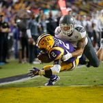 LSU cornerback Kevin Toliver II (2) intercepts a pass intended for Eastern Michigan wide receiver Dustin Creel (3) in the second half Saturday.