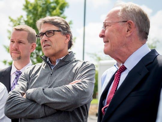 Secretary of Department of Energy Rick Perry, left,