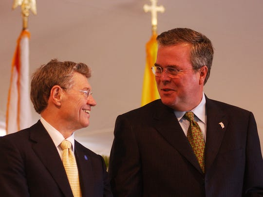 Ave Maria founder Tom Monaghan and former then-Florida Gov. Jeb Bush share a laugh during a construction kickoff ceremony on Feb. 17, 2006.