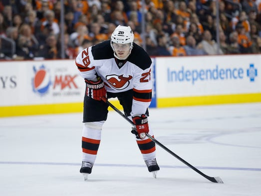 New Jersey Devils defenseman Anton Volchenkov in action during a game against the Philadelphia Flyers, Tuesday, March 11, 2014, in Philadelphia.