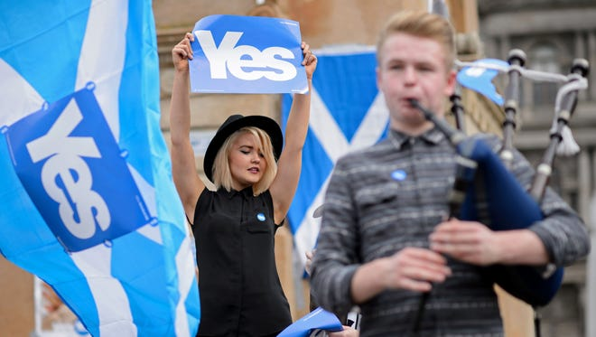 People gather for a pro-independence rally in Glasgow's George Square in Scotland on Sept. 17 before the referendum on independence.