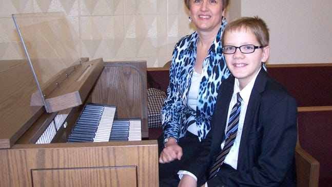Rosanne Patterson and her son Joseph, 12, serve as senior organist and assistant organist, respectively, for the York Ward of The Church of Jesus Christ of Latter-day Saints.