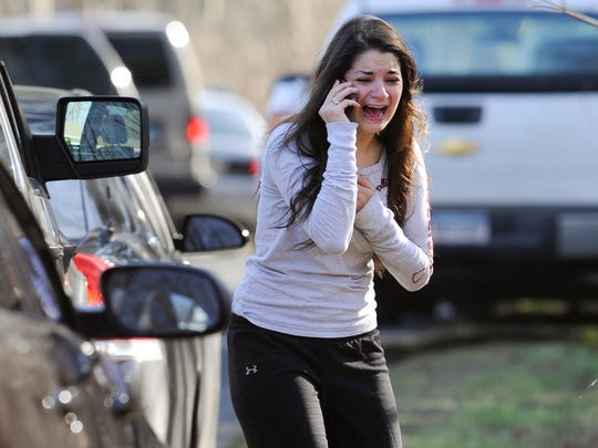 Carlee Soto uses a phone to get information about her sister, Victoria Soto, a teacher at the Sandy Hook elementary school in Newtown, Conn. Friday, Dec. 14, 2012, after a gunman killed over two dozen people, including 20 children. Victoria Soto, 27, was among those killed.
