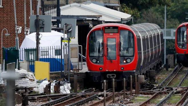 A police forensic tent stands next to the train platform after a homemade bomb exploded at Parsons Green subway station in London on Friday.