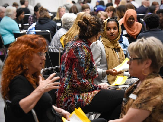 Participants engage in small group discussions during Conversations On Race Tuesday, Oct. 17, at the River's Edge Convention Center.
