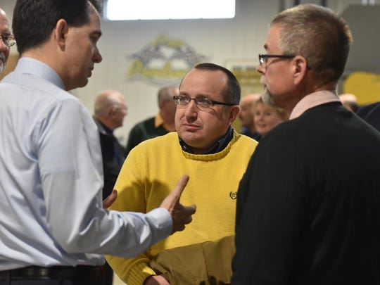 City Administrator Josh VanLieshout, middle, with Gov. Scott Walker, left, and Mayor Thad Birmingham, right, in a file photo.