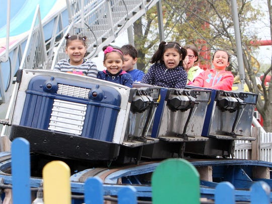 A variety of expressions on the faces of the kids riding the Kiddy Coaster during opening day of Playland in Rye May 9, 2015.