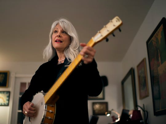 'It took years before I'd sing without a guitar in front of me,' says Carolyn Hannan, a Cinnaminson resident and folksinger. 'I'd try to talk to the audience, which can be hard for a performer, and I'd tell stupid jokes. I could sing but I couldn't talk.'