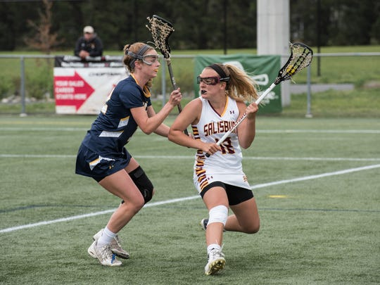 Salisbury's Lindsey Wagner, right, works the offensive zone during a game against St. Mary's College of Maryland on Saturday, April 30, 2016.