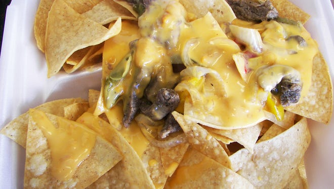 The nachos ($4.99) can also be topped with your choice of meat (pictured is the fajita steak).