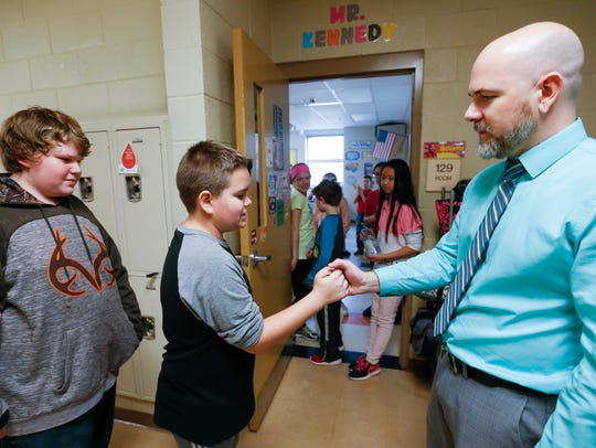Fifth-grade teacher Joshua Kennedy, 35, and Brody Romine,